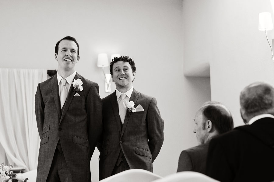 Groom and best man nervously await