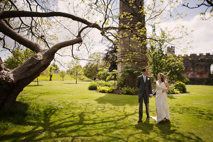 The newlyweds take a stroll through Wells' Bishop's Palace Gardens