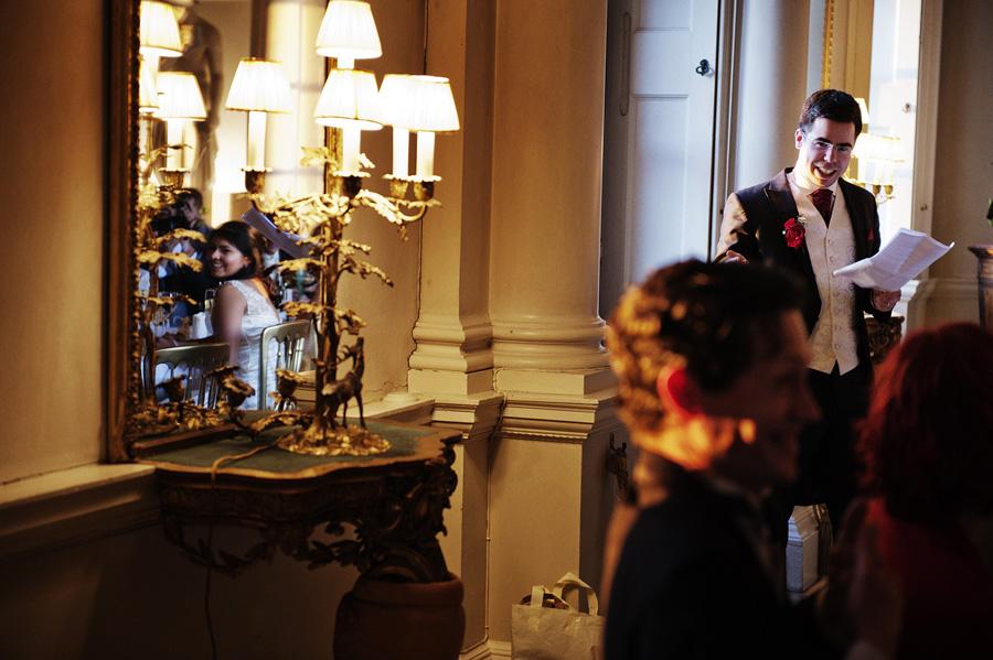Bride reflected in mirror during grooms speech