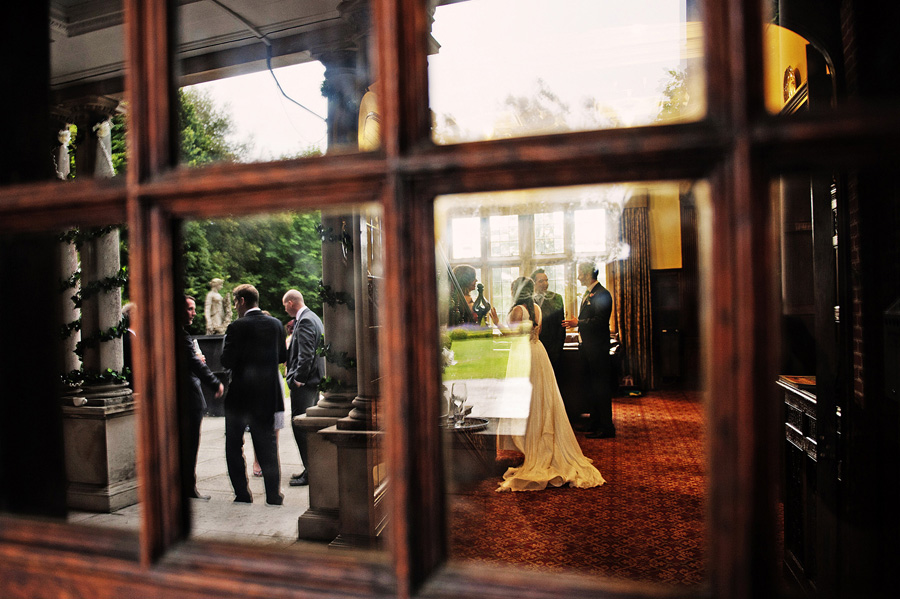 Inside and outside wedding reception reflection image