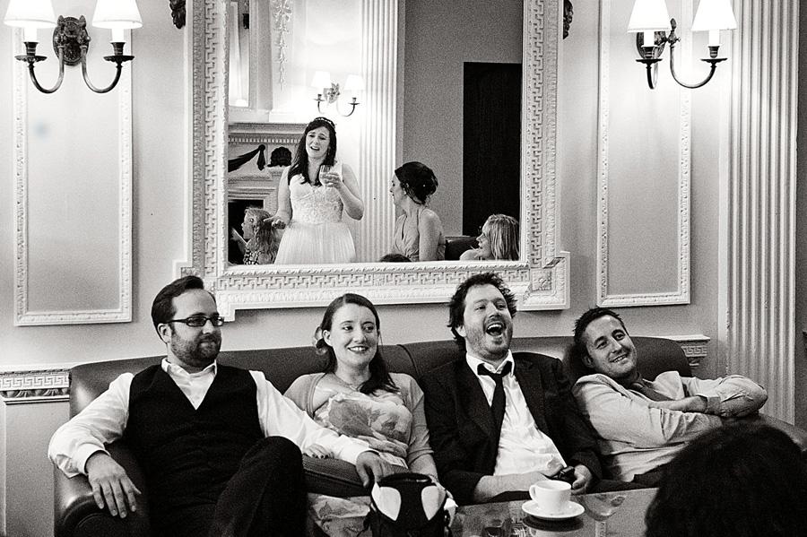 Guests at wedding reception reflection shot