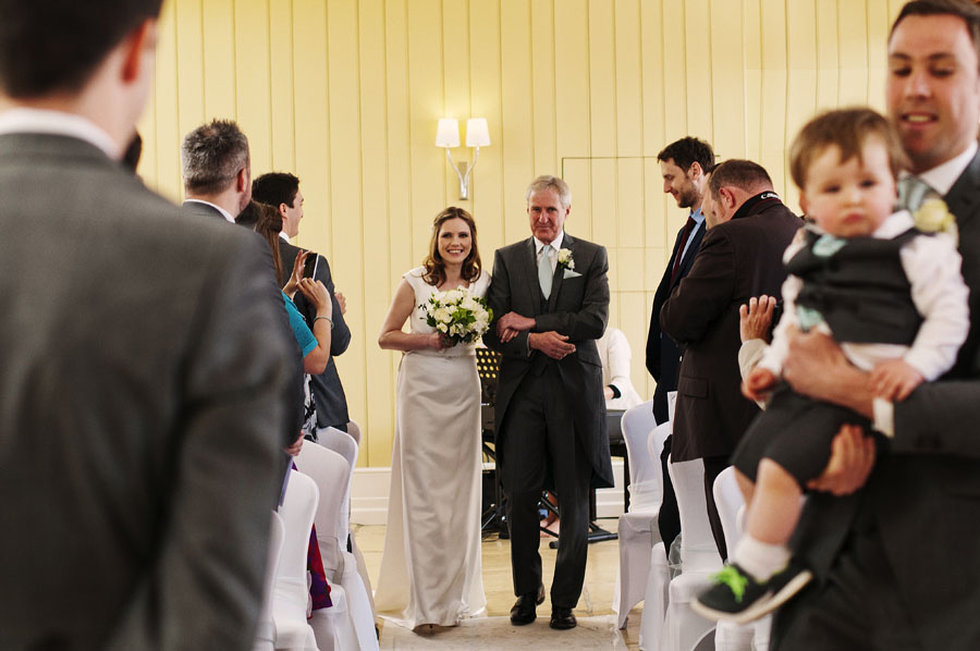 The bride enters the room