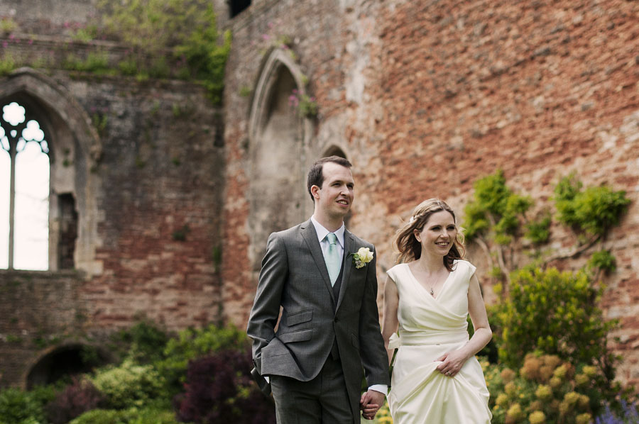 The newly married couple take a stroll through Wells' Bishop's Palace Gardens