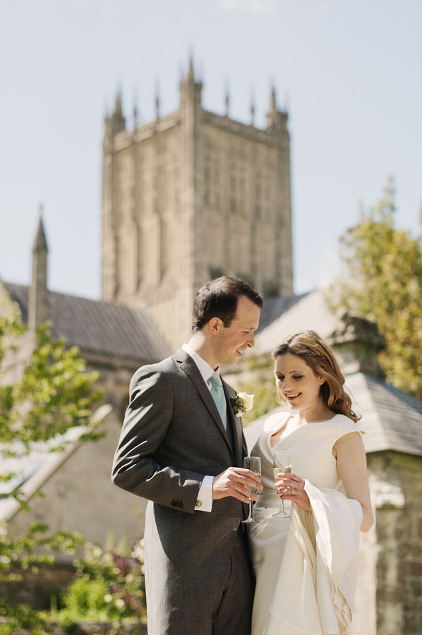 The happy couple have a moment with Wells Cathedral in the background