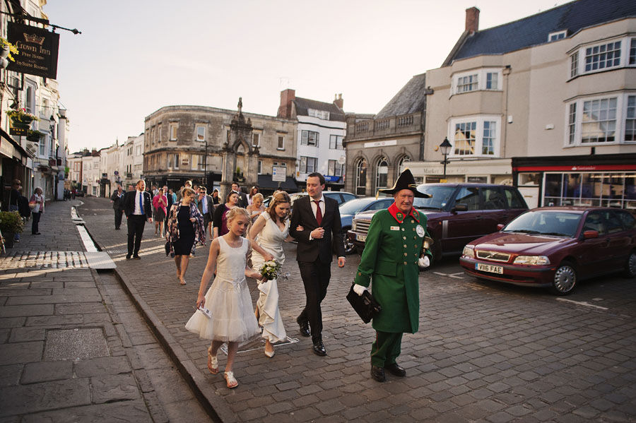 The wedding party makes its way to Wells Town Hall for the evening celebrations